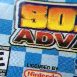 Label pirata também impressa em off-set. O logotipo Nintendo também é pontilhado